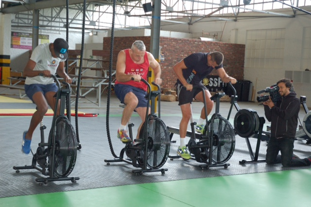 Training on assault bikes at John's gym with Olympic Gold Medalist Ryk Neethling and World Long Jump Champion Luvo Manyonga