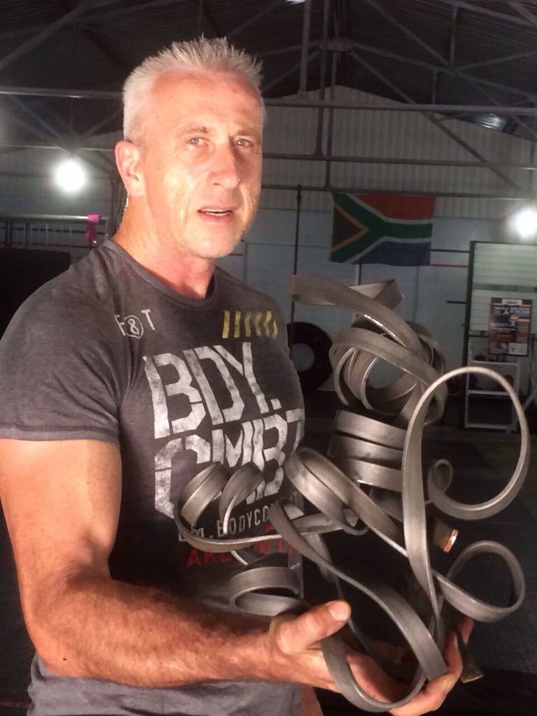 John's Brutal Arts - A 5m long steel bar twisted & shaped. FitLife Gym, Paarl, Cape Town